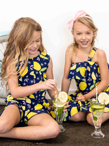 Two girls in lemonade dress and playsuit