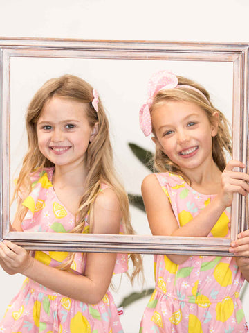 Two girls in pink lemon dress and playsuit