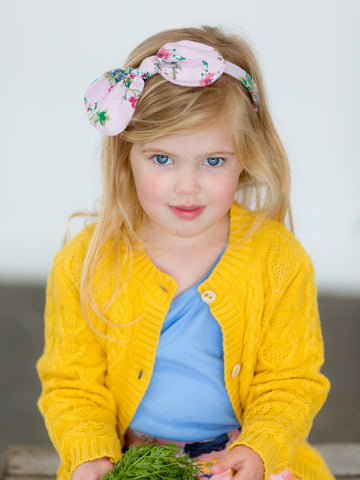 Girl in yellow cardigan