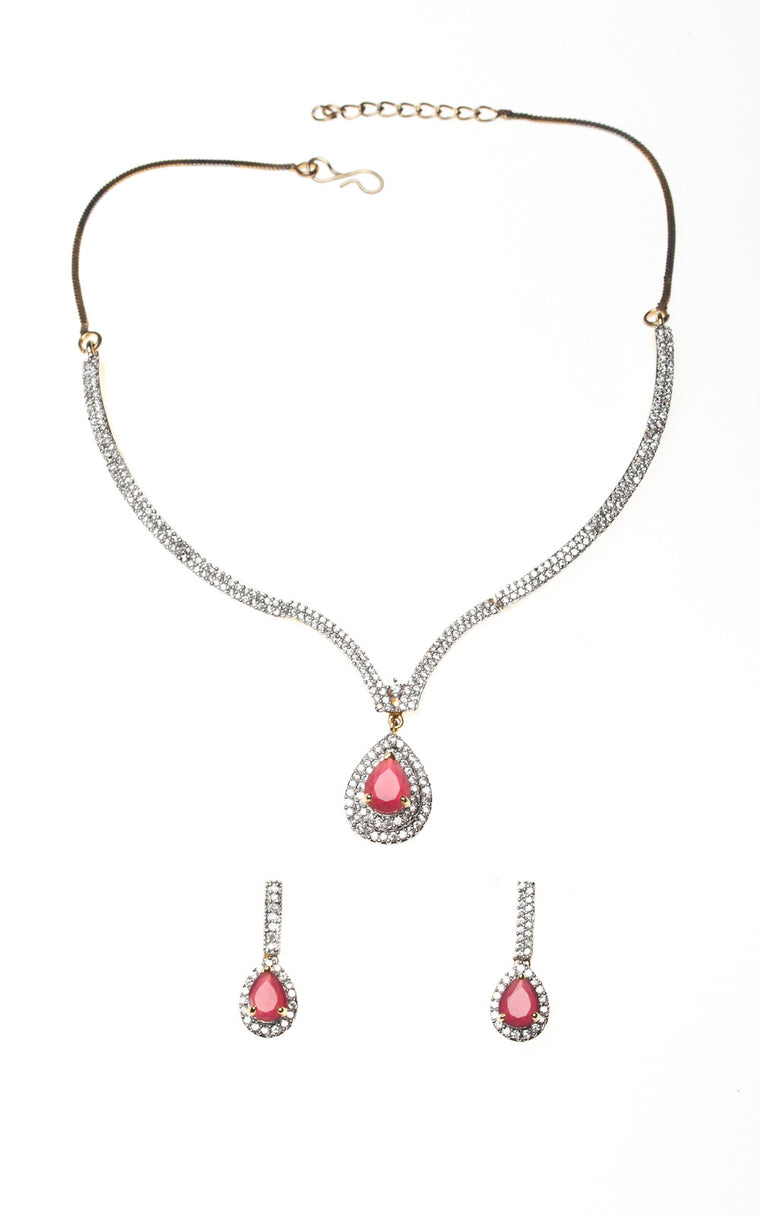 An American Diamond set with dark pink teardrop stone