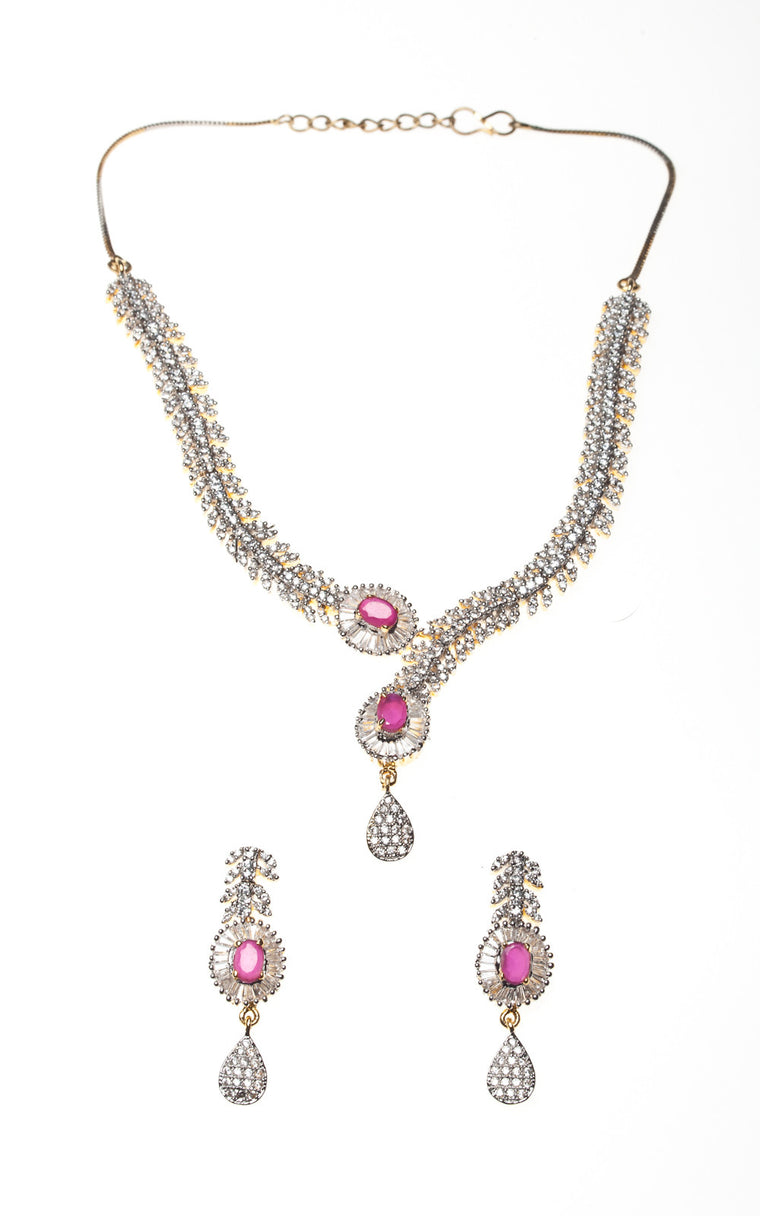 An American Diamond vine-leaf design necklace and earrings set with pink stones
