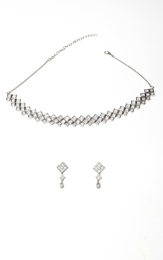 Clear Austrian crystal necklace and earrings set in diamond shape design
