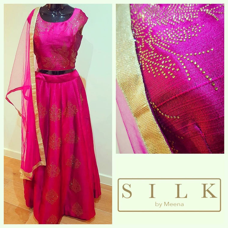 Plum dupion silk lengha with Swarovski gold stud work