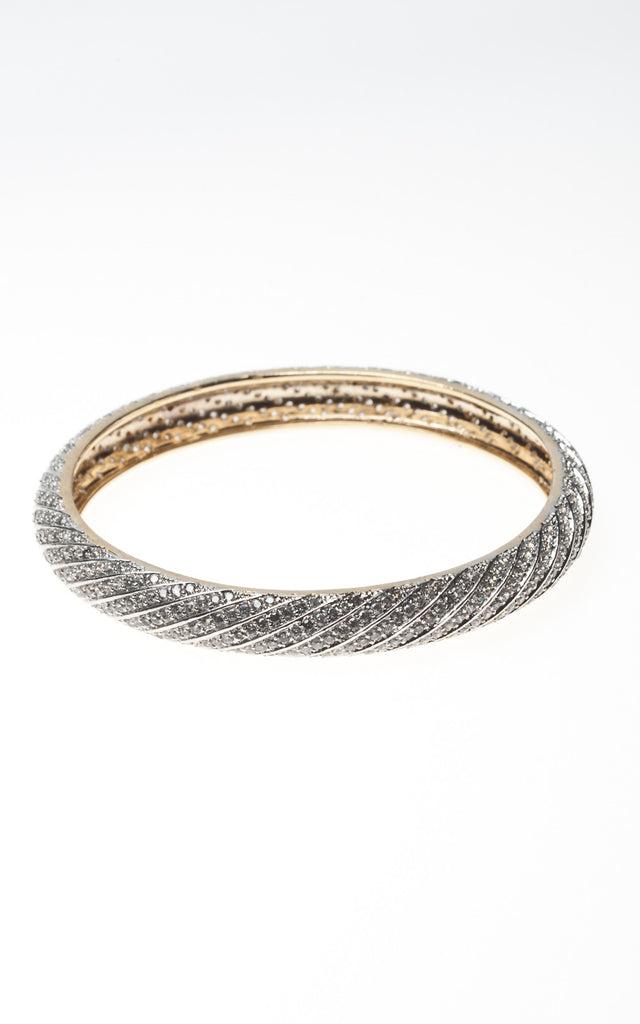 Fancy swirled diamante bangle