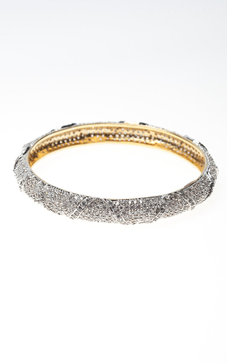 Heavy bangle of swirled diamante