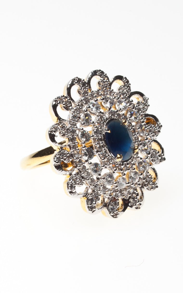 Sapphire coloured stone in a cascade of diamante ring