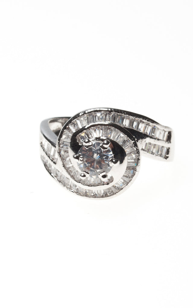 Solitaire in a swirl of diamante on a silver band