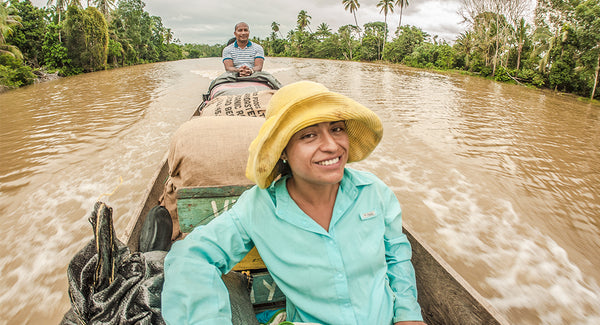 Paola transporting cacao