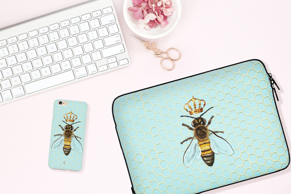 Matching Queen Bee with Crown laptop sleeve and shockproof iPhone case in flatlay