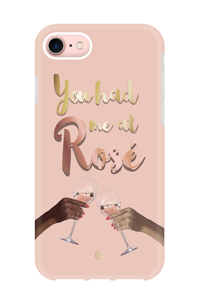 "Pink shockproof iPhone case with design of two hands clinking rosé glasses and text that states ""you had me at rosé"""