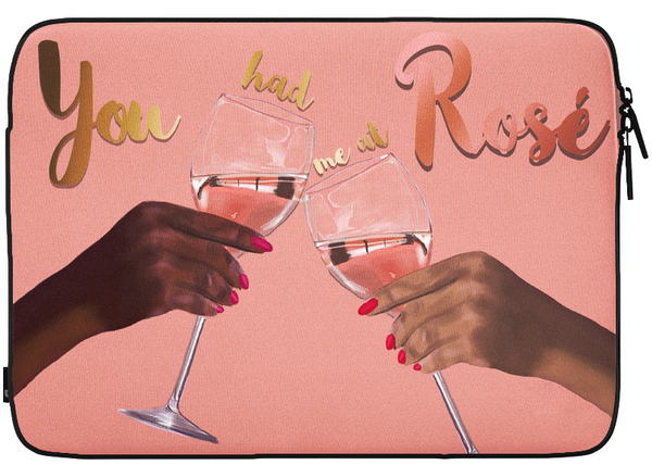 "Pink laptop case with hands holding glasses clinking Rosé wine glasses and designs states ""you had me at rosé"""