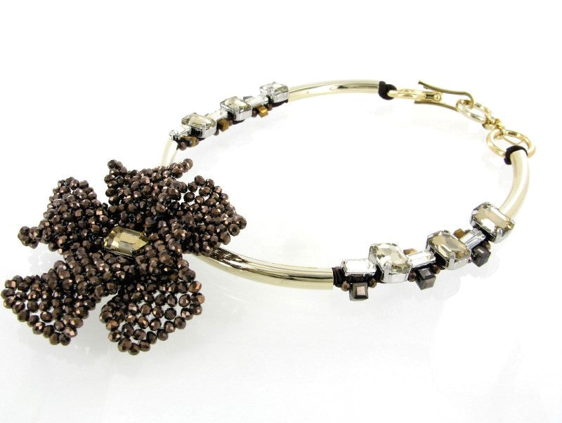 Brown beaded flower with gold metal collar