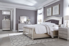 Coralayne King Arched Panel Bed w/ Dresser Mirror & Nightstand