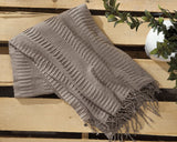 Mendez Taupe Throw - Ashley shop at  Regency Furniture