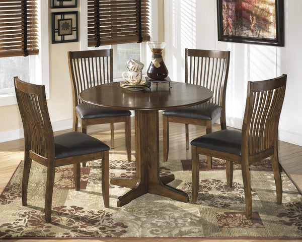 Stuman Table + Four FREE Chairs - Ashley shop at  Regency Furniture