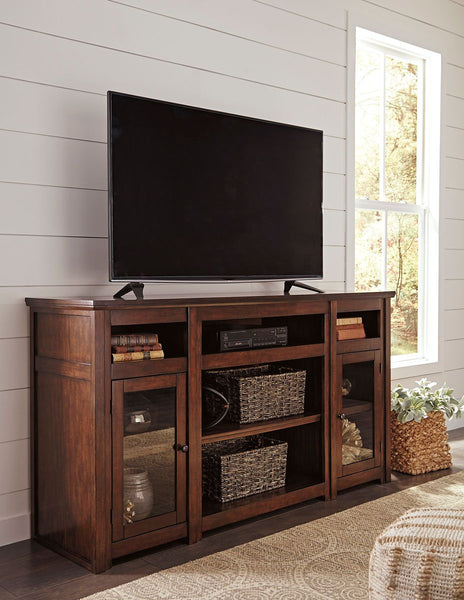 Harpan  Reddish Brown Extra Large Tv Stand - Ashley shop at  Regency Furniture