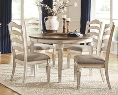 Realyn Chipped White Table & 4 Ladder Back Side Chairs