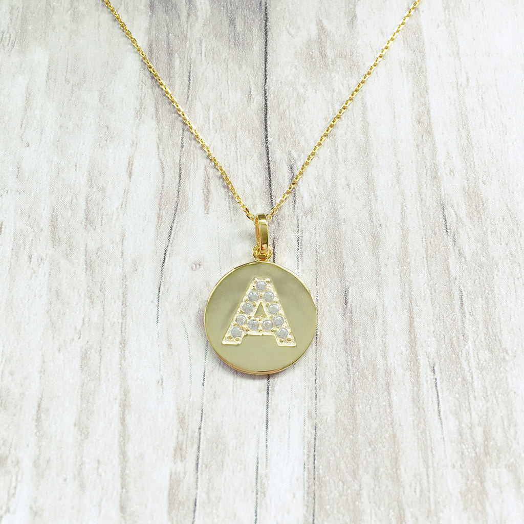 Gold initial disc pendant necklace alana jasmine jewellery gold initial disc pendant necklace aloadofball Image collections