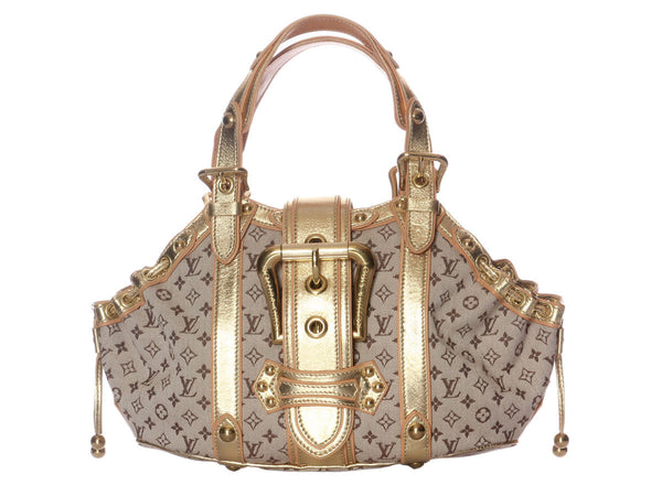 Louis Vuitton Ecru Theda GM