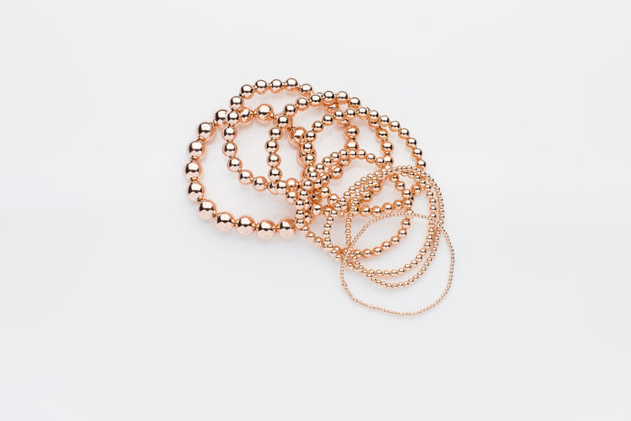 14k rose gold and 14k rose gold filled stretch bead bracelets, rings, necklaces and earrings