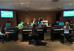 The ONE Piano Classroom - A piano that teaches you to play.