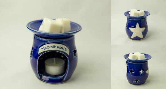 The tealight wax melt warmer comes in a stunning, deep blue with a large, white star on the back which is flanked by 3 star cut-outs that provide beautiful illumination when lit