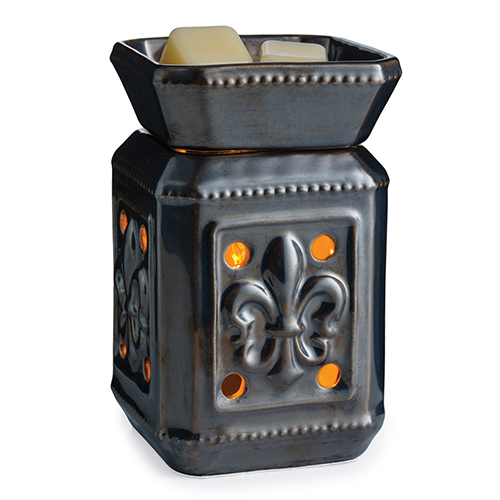 The Fleur de Lis wax melt warmer is made out of brown-black ceramic with a fleur de lis motif embossed on the sides