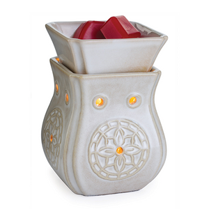 The Insignia Midsize Illumination wax melt warmer has a white glazed body with flower medallions on each side