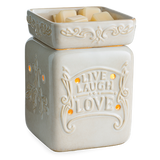 The Live Well warmer has the words 'Live Laugh Love' embossed on a white glaze surface