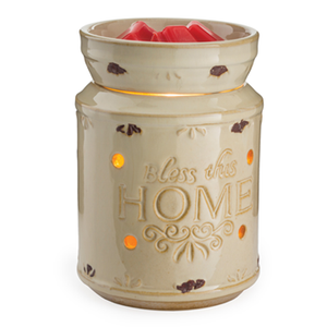 "Bless This Home wax melt warmer has a French country style made with a ceramic, cream white container that has the words ""Bless this home"" embossed on the front"
