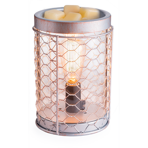 The Chicken Wire Edison Bulb wax melt warmer features an exposed amber Edison bulb behind a copper wire mesh