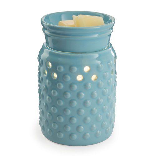 The Hobnail Blue wax melt warmer has a porcelain hobnail body in a pretty robin's egg blue