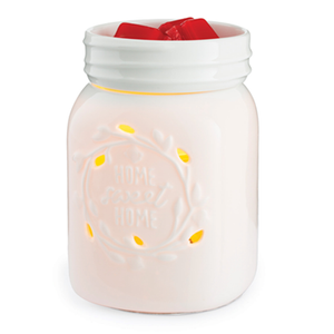 "The Mason Jar wax melt warmer is made of white porcelain with the words ""home sweet home"" on the sides"