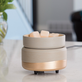 The Midas wax melt warmer is shown with wax melts in its top dish
