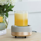 The Midas wax melt warmer is shown with a 10 oz. candle on its bottom warming plate