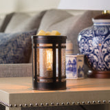 The Mission Edison Bulb wax melt warmer sits on a living room side table