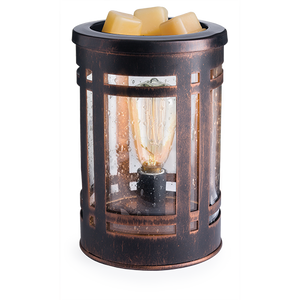 The Mission Edison Bulb warmer features an exposed Edison bulb in an oil bronze metal case behind bubbled glass