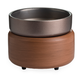 The Pewter Walnut wax melt warmer has a round, faux wooden base in a rich, medium brown with a pewter dish on top