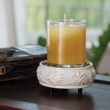 2-in-1 Sandstone wax melt warmer sits disassembled on a table with a candle on the lower base