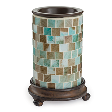The Mosaic Sea Glass wax melt warmer is made of sea foam green, brown, and tan square, glass mosaic tiles that sit on a dark wood base