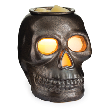 The skull wax melt warmer has a dark, matte metallic finish and an illuminated eyes and nose when the warming bulb is turned on
