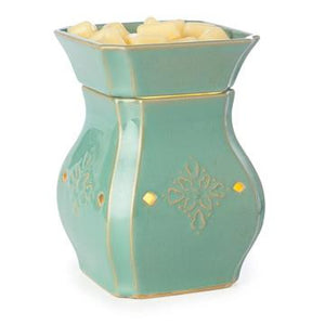 The Vintage Turquoise wax melt warmer has an hourglass body made of turquoise ceramic with a medallion embossed on each side