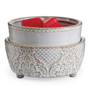 The Vintage White 2-in-1 wax melt warmer has a short, large round body made of a white reactive glaze and soft, brown scalloped design