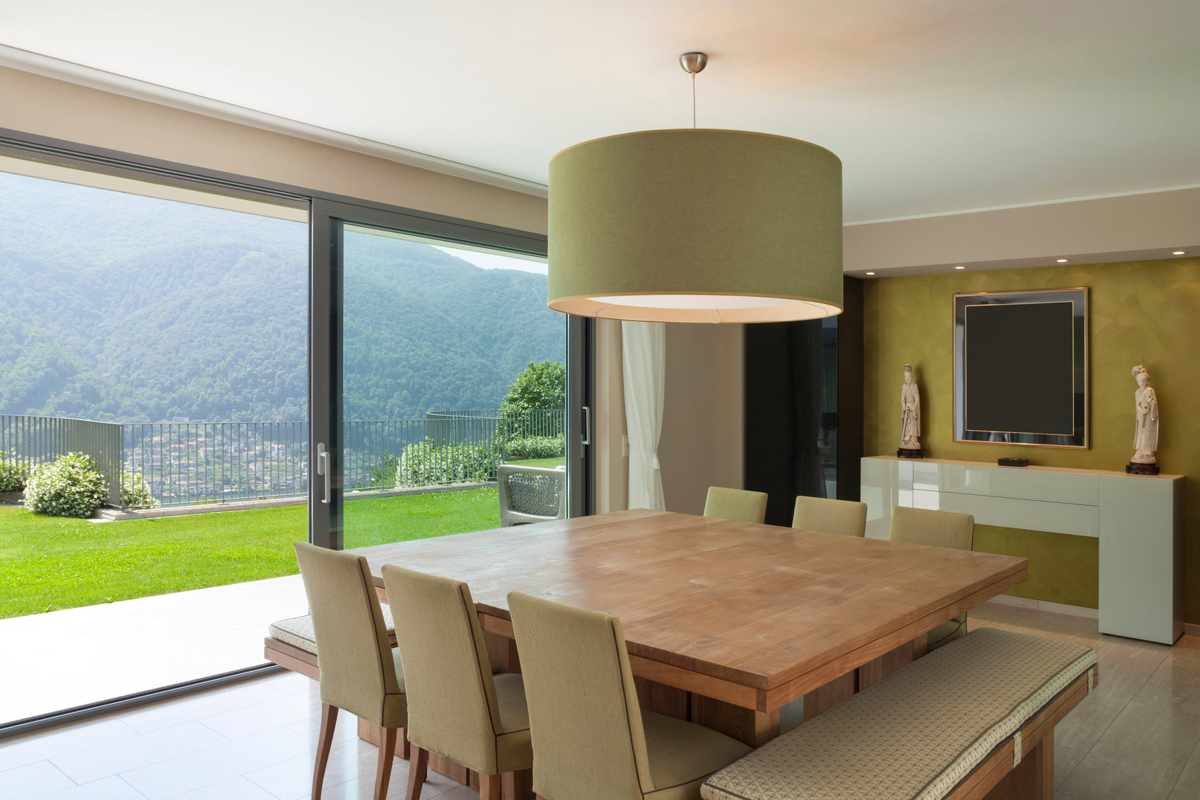 Use a variety of seating options including benches and armless chairs, in a big dining room