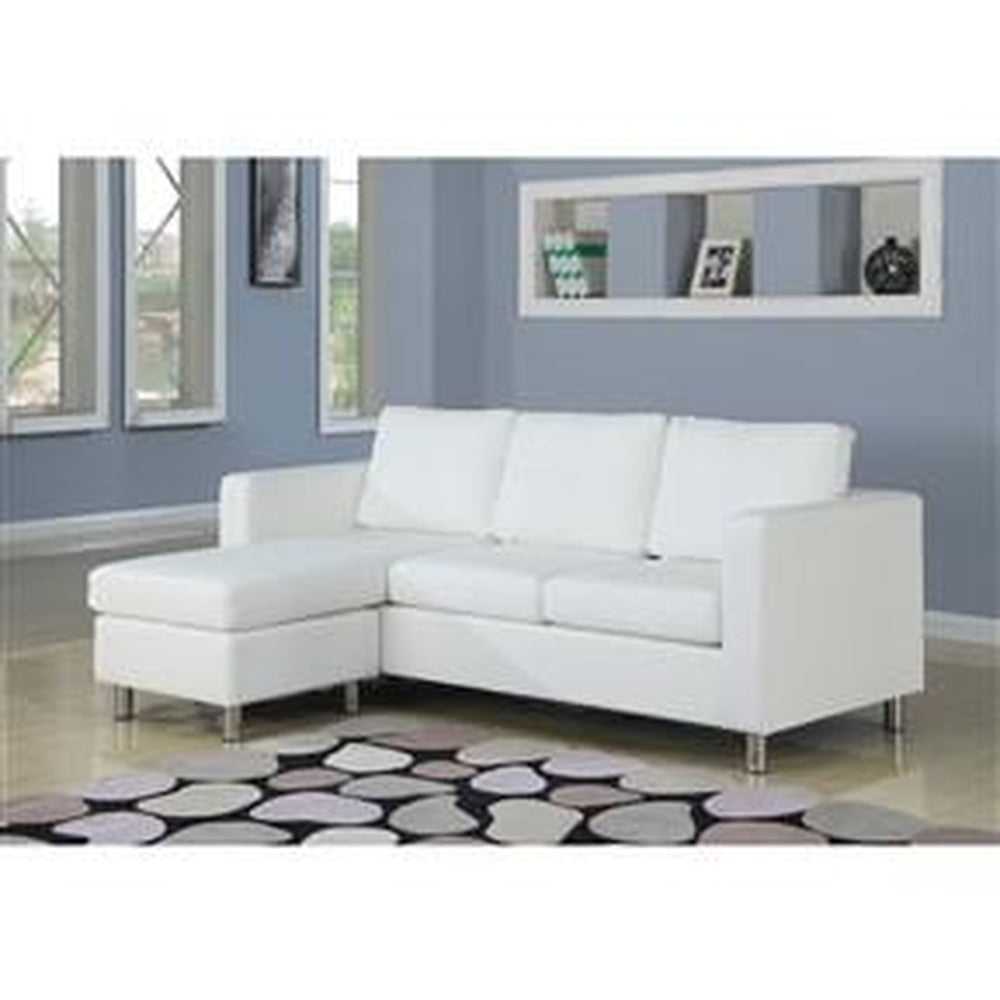 ... WHITE FAUX LEATHER SECTIONAL SOFA WITH REVERSIBLE CHAISE