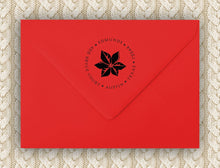 Single Poinsettia Holiday Personalized Self-inking Round Return Address Stamp on Envelope