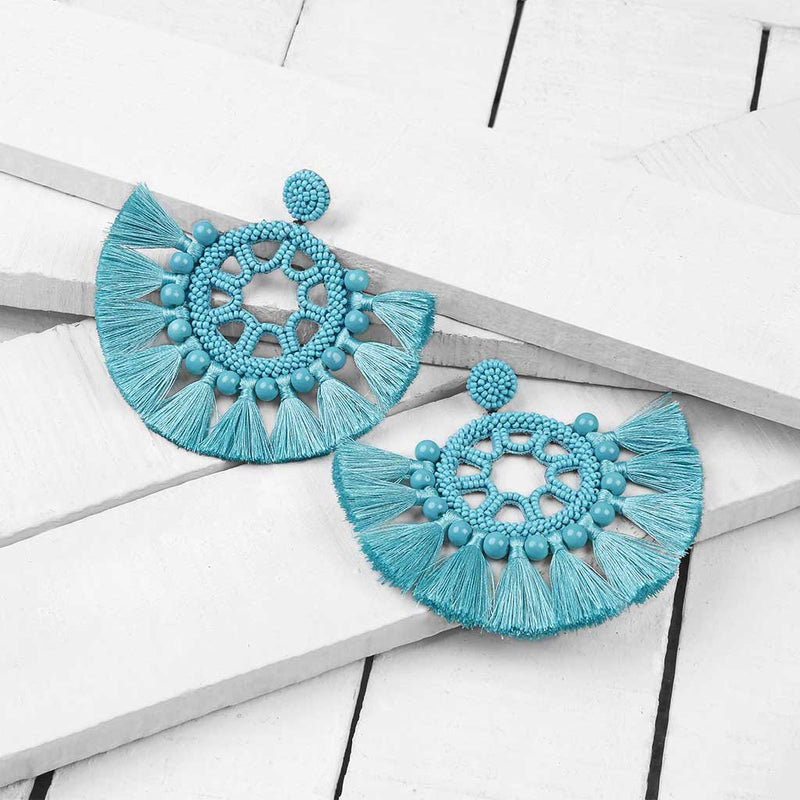 Deepa by Deepa Gurnani Handmade Lacey Earrings in Turquoise on Wood Background