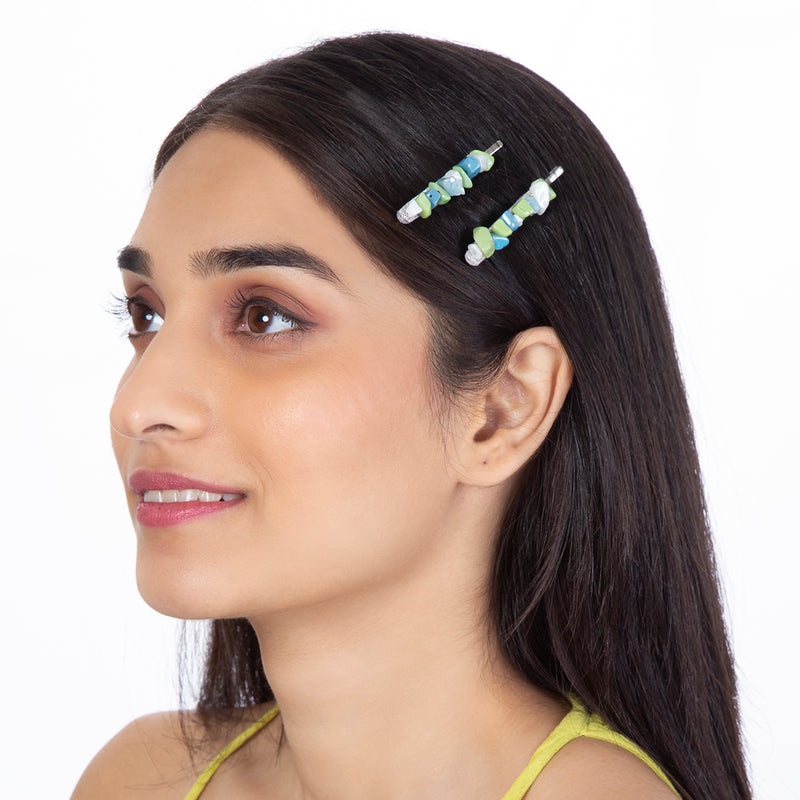 model wearing handmade blue stone beaded bobby pin set