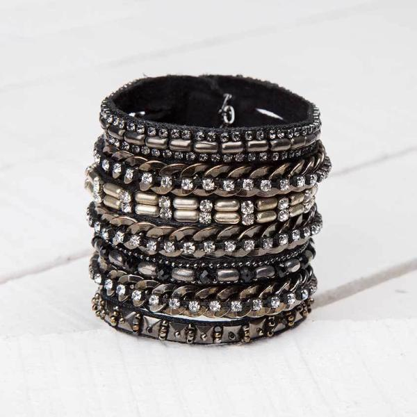 Deepa by Deepa Gurnani Handmade Cersei Cuff in Gunmetal on Wood Background