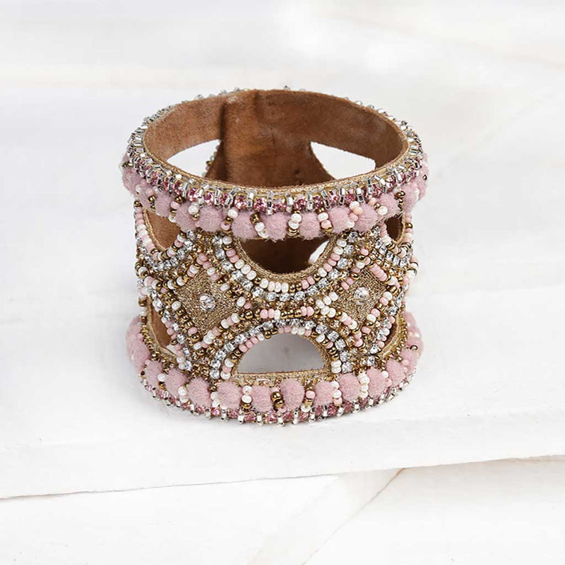 Deepa by Deepa Gurnani Handmade Keiko Cuff in Pink on Wood Background